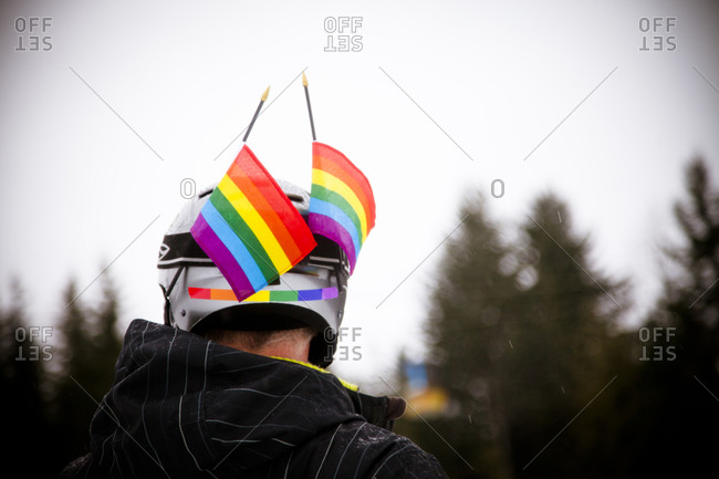 Person with rainbow flags on helmet