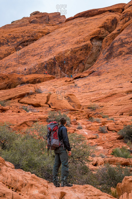 Backpacker watches climbers at Red Rock Canyon National Conservation Area