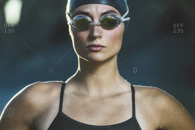 Portrait of a competitive swimmer with swim cap and goggles