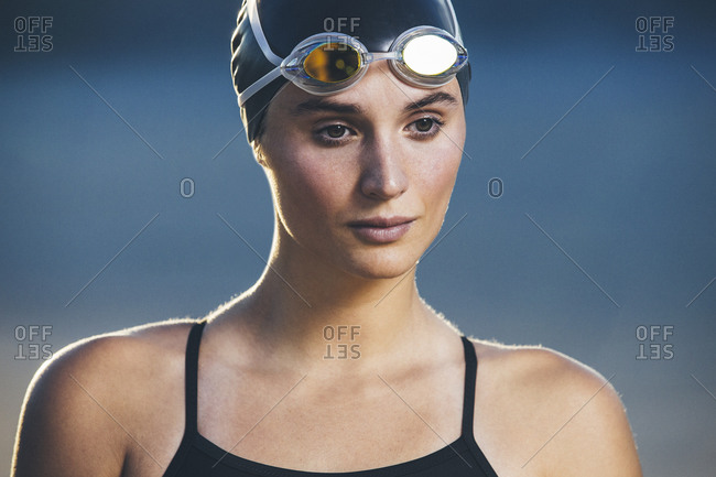 Closeup of swimmer with goggles on her forehead