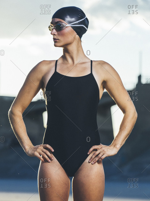 Competitive swimmer standing on beach