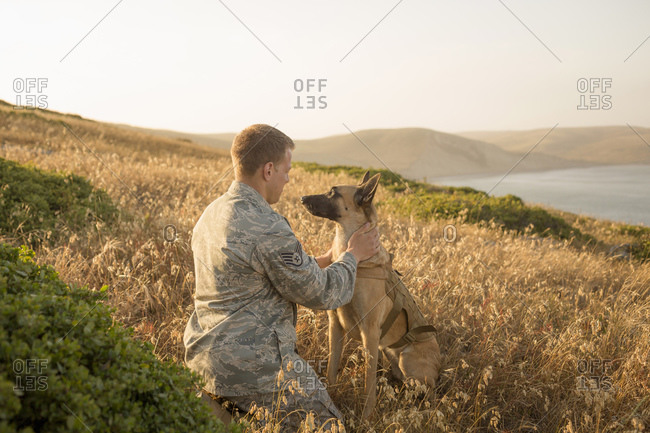 Airman with his Military Working Dog on hill
