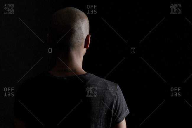 Back of a young woman with a shaved head