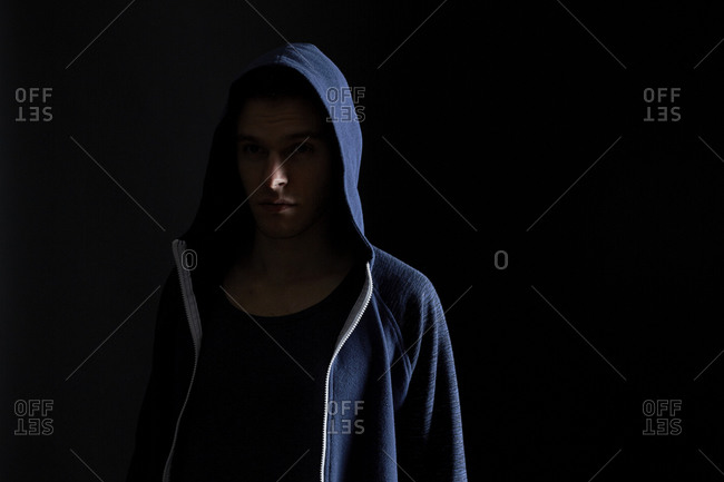 Young man in a blue hoodie