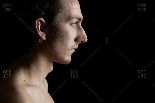 Profile of a young shirtless man