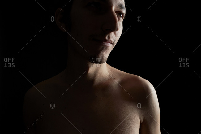 Portrait of a young shirtless man smiling