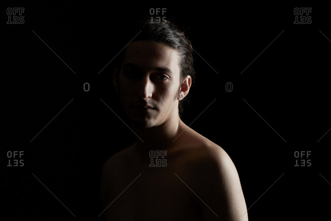 Shirtless young man gazing at the camera