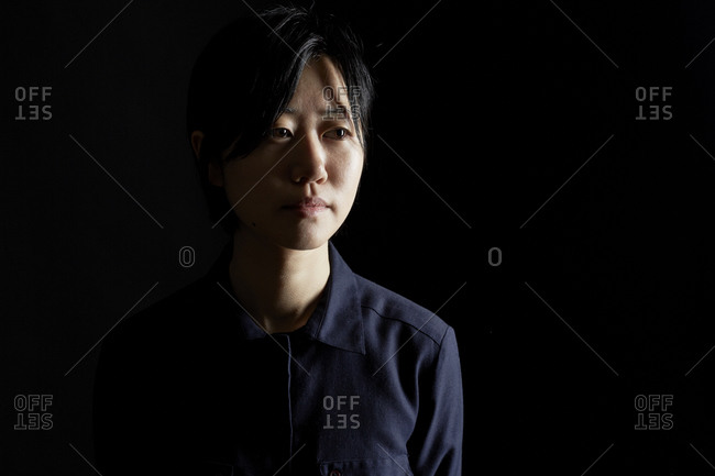 Stoic young woman in a blue shirt