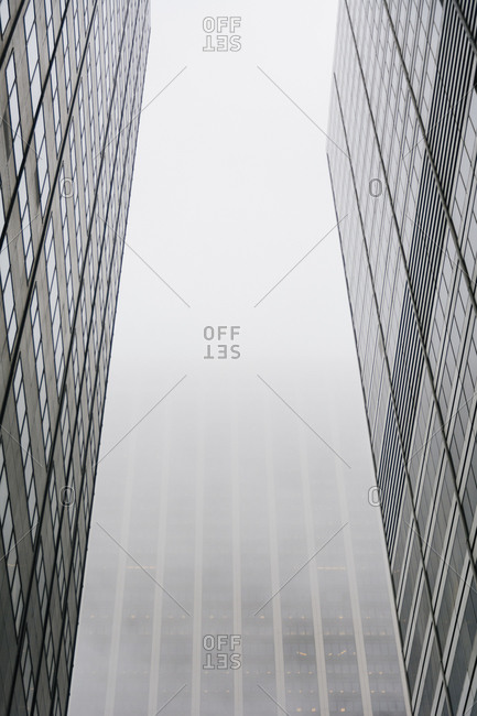 Modern city buildings in the fog in New York City