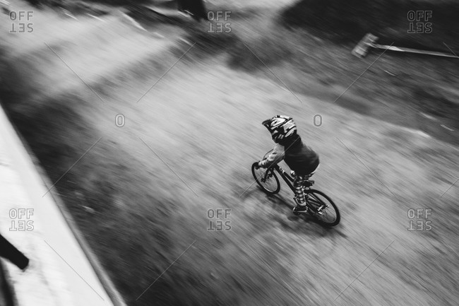 Boy riding a bike on a dirt track