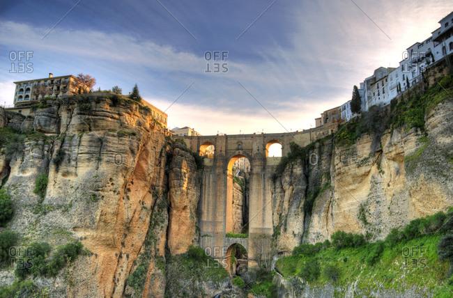 Punto Nuevo Bridge and cliffs at sunset, Ronda, Spain