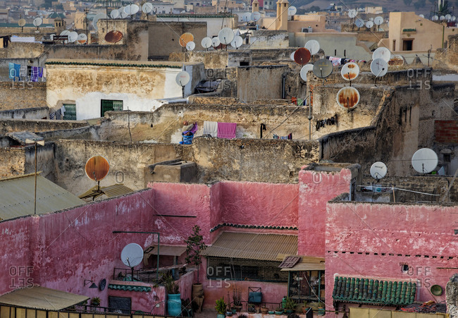 Pink walls and satellite dishes in Fes, Morocco