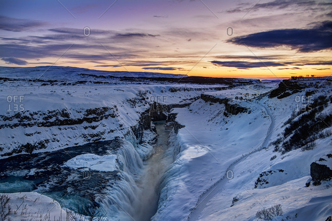 Gullfoss waterfall and observers at sunset in Iceland