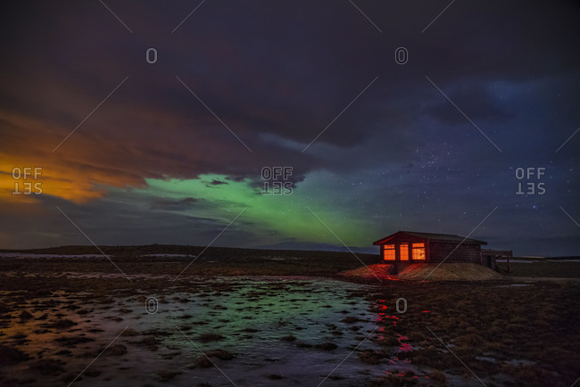 Northern lights and cabin in Hella, Iceland