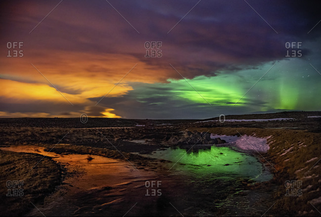 Northern lights over a river in Hella, Iceland