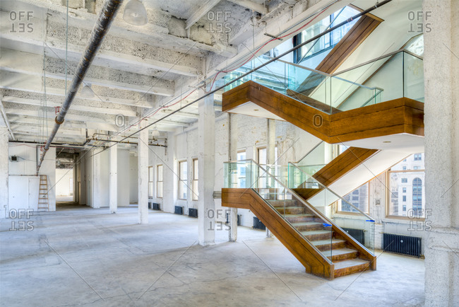 New York, NY - April 12, 2015: Vacant office space with open staircase