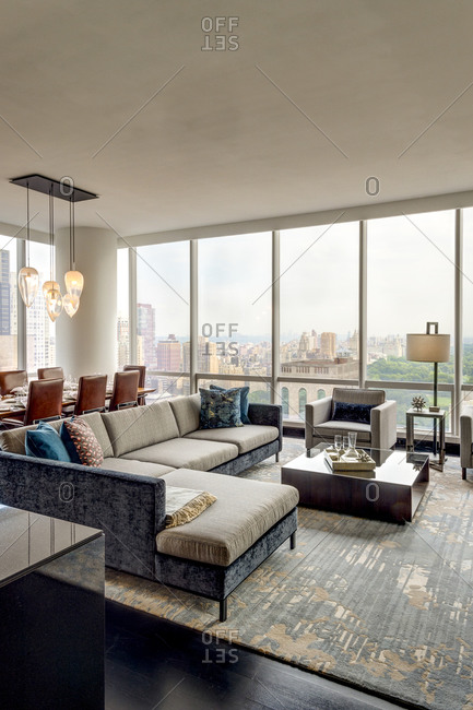 New York, NY - July 27, 2015: Living and dining room with a view of Central Park