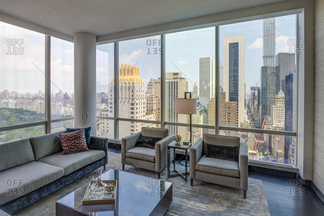 New York, NY - July 27, 2015: Luxury high-rise apartment living room with view of Central Park