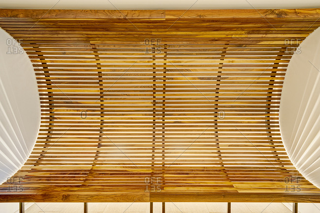 New York, NY - December 13, 2014: Close-up of a curved wooden slatted bench
