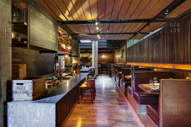 New York, NY - December 16, 2014: Entrance to an upscale restaurant with booths along wall