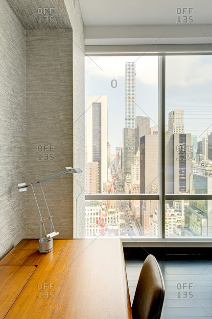 New York, NY - July 27, 2015: Desk in luxury high-rise building with view of Manhattan