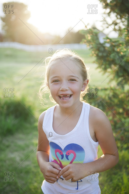 Portrait of a smiling girl missing front teeth