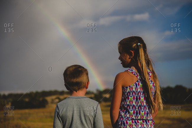 Children looking at a rainbow