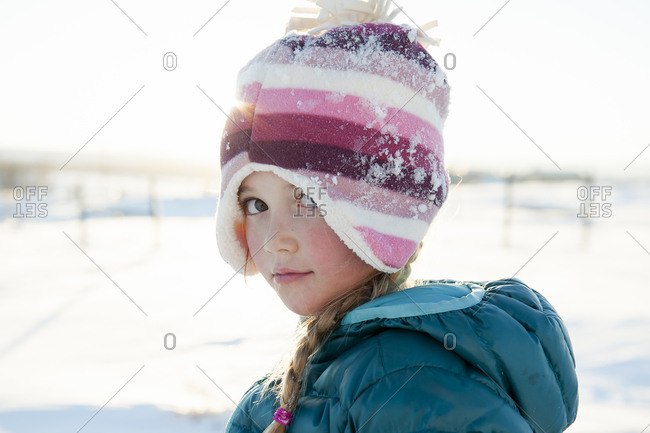 Portrait of a little girl in the snow
