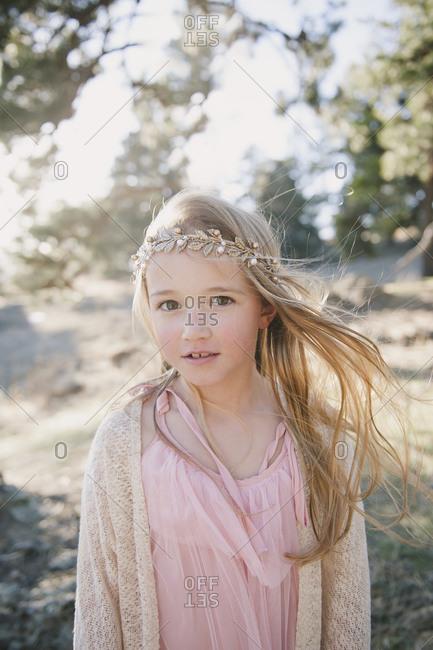 Portrait of a little blonde girl wearing gold headband