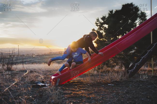 Children climbing on a slide