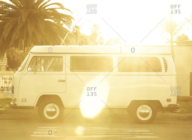 Hermosa Beach, California - December 31, 2012: Vintage van parked on a roadside at sunset