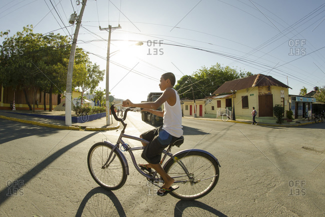 San Juan del Sur, Nicaragua - February 16, 2015: Boy riding a bike in the streets