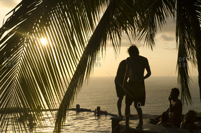 Santa Teresa, Costa Rica - February 26, 2015: Friends hanging out at a beachside pool