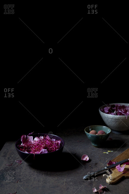 A pink salad with chicory, beet sprouts and lychee served in a bowl
