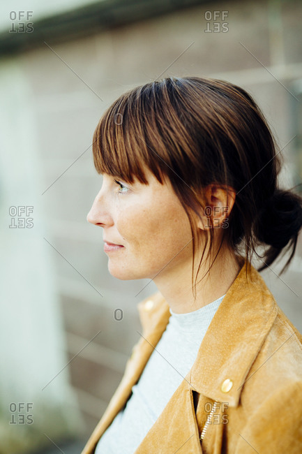 Profile of a woman wearing a tan jacket