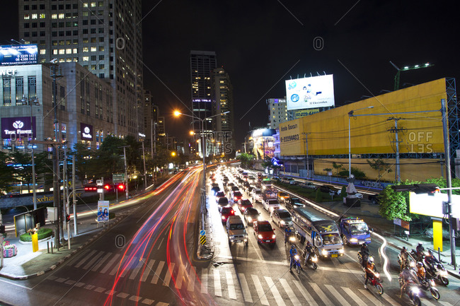 Busy intersection at night in Bangkok, Thailand