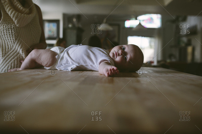 Newborn lying on a table