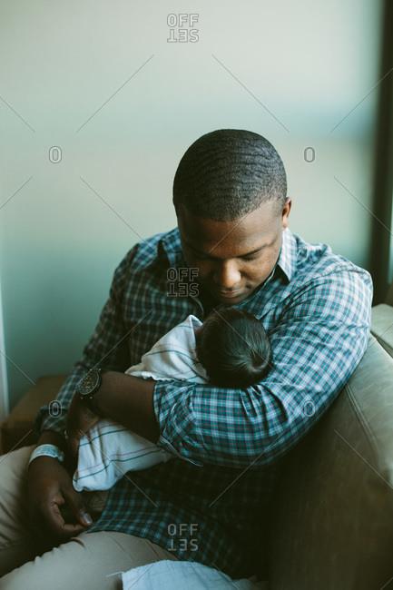 Father cradling his newborn
