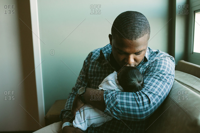 A father holding his newborn