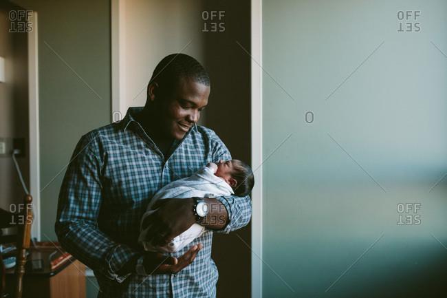 Father gazing at his newborn