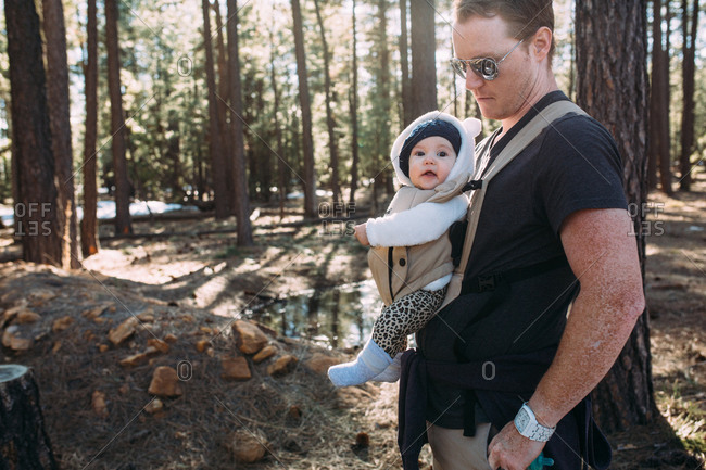 Baby and dad in woods