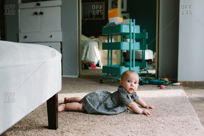 Baby propped up on floor
