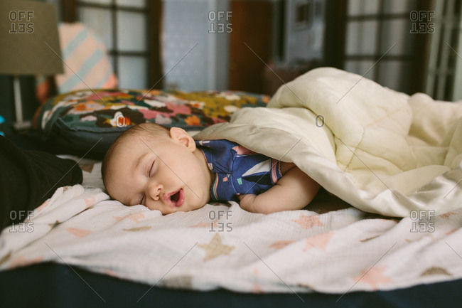 A baby fast asleep at home