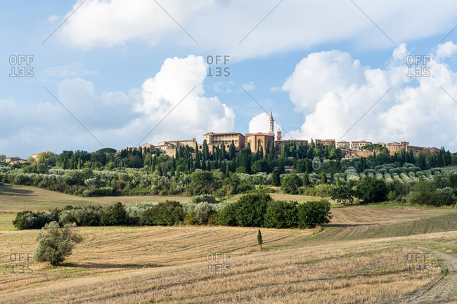 Siena, Tuscany, Italy - August 24, 2015: View of Pienza skyline in from the Tuscan countryside