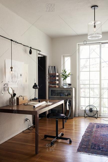 Los Angeles, California - September 22, 2014: Drafting table in Alison Berger's studio