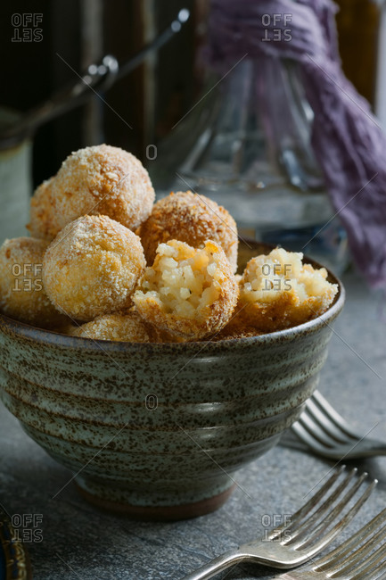 Risotto bon bons in an earthenware bowl