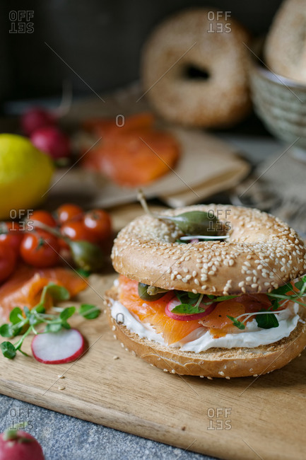 Smoked salmon and cream cheese bagel, on a cutting board