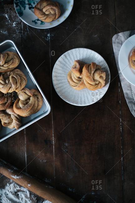 Freshly baked cinnamon buns served on plates