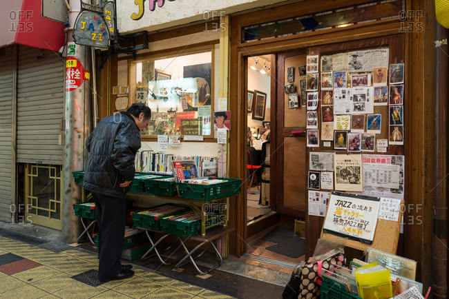 Osaka, Japan - January 3, 2016: Man looking at books in front of a bookstore in Osaka, Japan