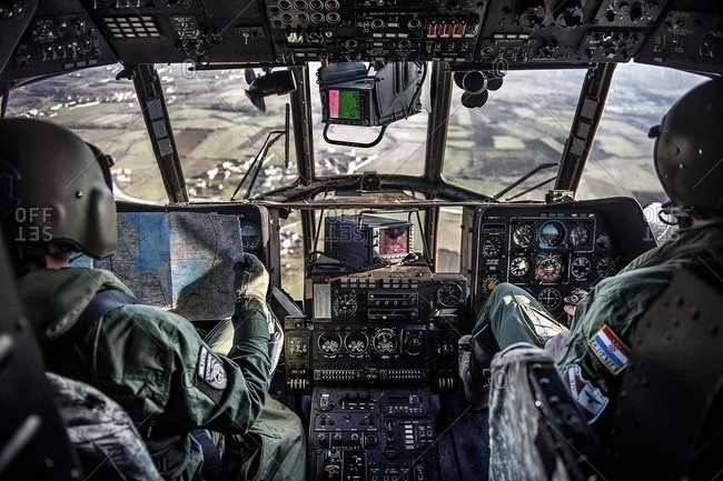 View of two Mi-17 helicopter pilots flying above Kosovo